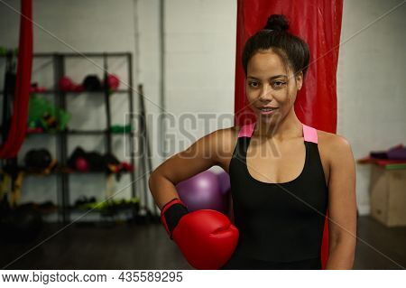 Young Female Boxer, Athlete Woman, Sporty Girl, Sports Woman, Wearing Red Boxing Gloves, Looks At Ca