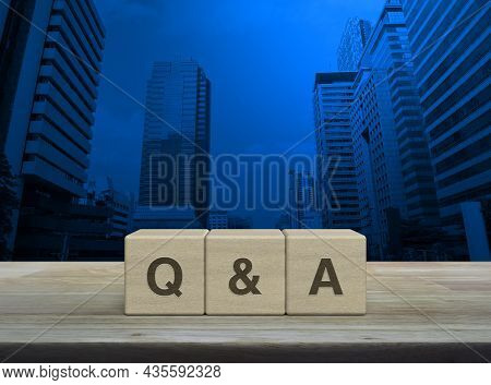 Q And A Acronym On Wood Block Cubes On Wooden Table Over Modern Office City Tower And Skyscraper, Fr