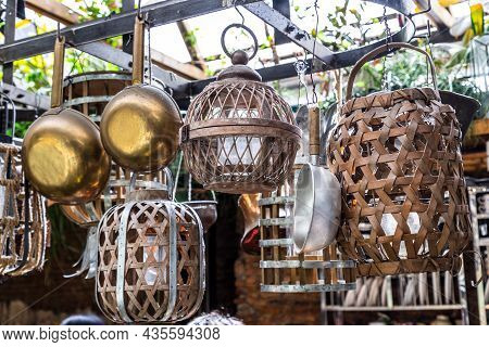 Cooking Utensils Hanging On Iron Railings In The Kitchen. Kitchen Appliances, No Focus, Specifically