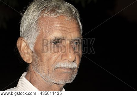Close Up Face Photo Of Retired Man Or Sharp Healthy Senior Indian Citizens With Black Isolated Low K