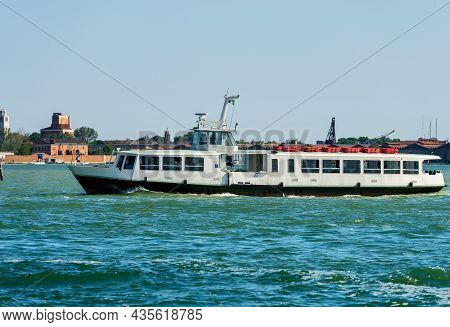 Empty White Ferry Boat Or Vaporetto In Motion In The Venetian Lagoon On A Sunny Spring Day. Venice,