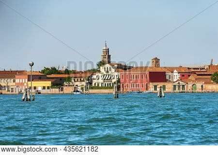 Cityscape Of Murano Island, Famous For The Production Of Artistic Glass With Its Ancient Bell Towers