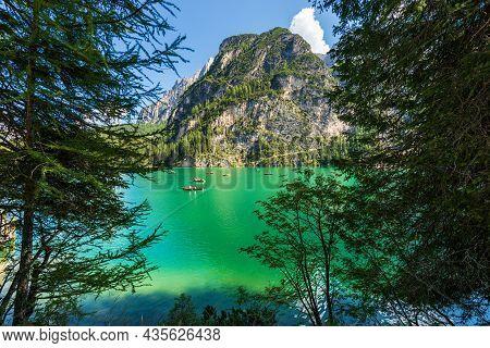 Lago Di Braies Or Pragser Wildsee. Small Alpine Lake And Mountain Range Of Sasso Del Signore. Dolomi