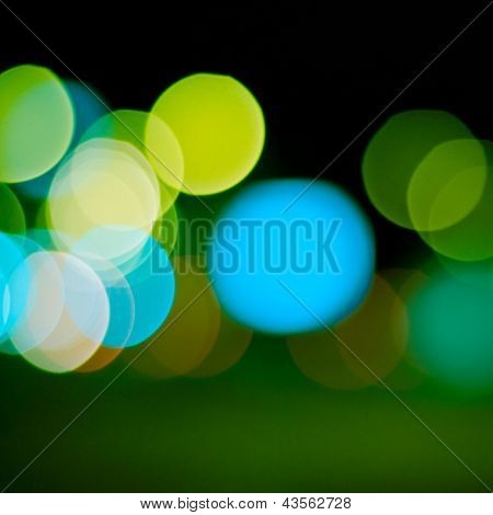 sparkling and defocused lights background. green bokeh background. abstract blurred lights poster
