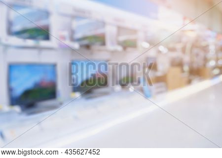 Television Shelves Retail Shop Display In Electronic Department Store Blurred Background