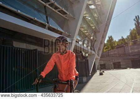 Active Millennial Caucasian Woman Cyclist In Sportswear Helmet Keep Fit Cycle Bike Outdoors On Weeke