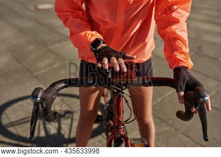 Close Up Crop View Of Sporty Active Sportswoman With Smartphone Cycle Exercise Follow Healthy Lifest