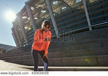 Active Toned Sportswoman Check Time On Smartwatch Run Jog Outdoors Keep Fit. Sporty Millennial Femal