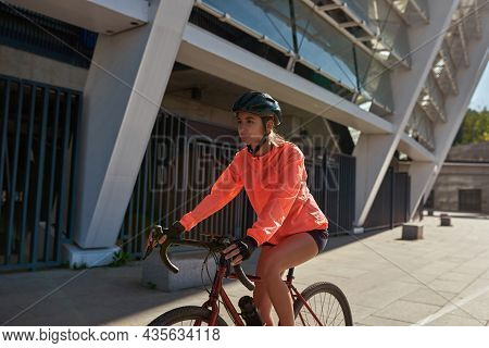 Sporty Toned Young Sportswoman In Helmet Cycle Bike Follow Healthy Lifestyle. Active Fit Millennial
