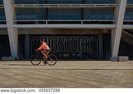 Active Toned Sportswoman Biker In Helmet Sportswear Ride Bicycle Cycle Outdoors On Weekend. Sporty F