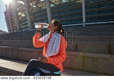 Thirsty Sportswoman Relax Rest After Workout Training Drink Water From Bottle. Active Toned Sporty G