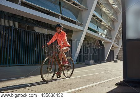 Happy Millennial Active Female Cyclist Biker In Helmet Sportswear Ride Bicycle Train Outdoor. Toned