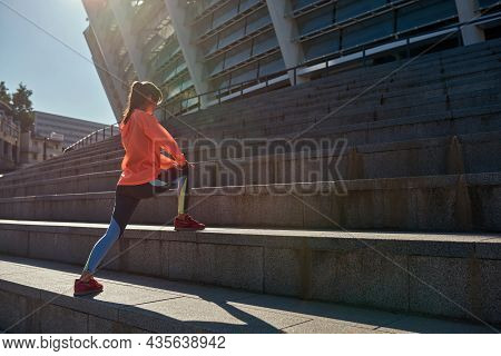 Sporty Toned Woman Runner In Sportswear Train Workout On Stairs Outside. Active Female Jogger Sports