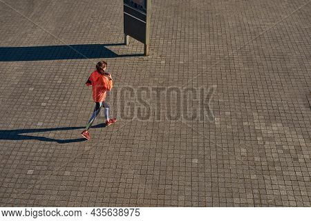 Top View Of Active Young 20s Female Runner Exercise Train Outdoors. Sporty Fit Woman In Sportswear K