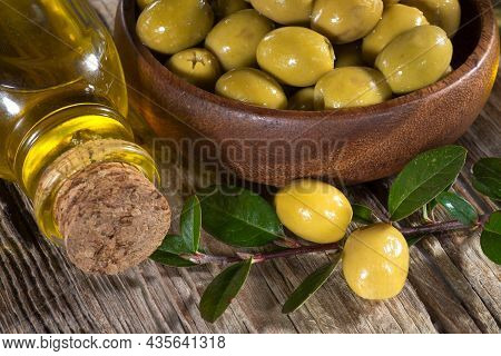 Olives Close-up And A Bottle Of Olive Oil