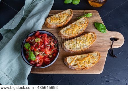 Fried Crispy Ciabatta Slices Sprinkled With Grated Cheese For Tomato Bruschetta, Top View