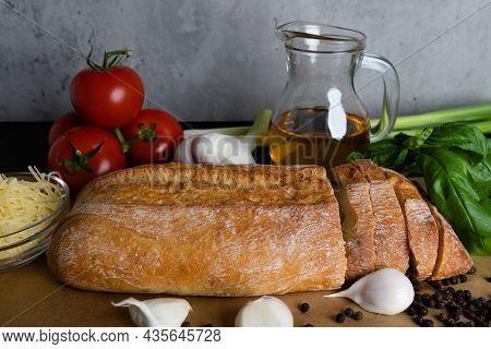 Italian Tomato Bruschetta With Chopped Basil, Garlic, Herbs And Oil On Toasted Crispy Ciabatta Bread