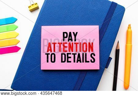 Word Text Attention To Detail On White Paper Background - Business Concept