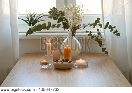 Four Different Golden Burning Candles, Vase With Eucalyptus Branches And A Bowl With Cookies, Festiv