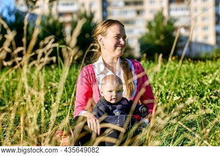 Smiling Woman 34 Years Old With Little Boy Is Walking In Park At Summer Day.