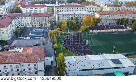 Aerial View Of All Weather Track And Field Stadium Around By Residential Buildings Inthe City. Top V