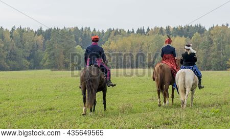 Group Of Fox Hunters On The Horses In The Autumn Field. Reconsruction Of Traditional Horse Hunting.
