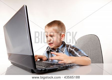 Computer Addiction Emotional Boy With Laptop