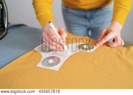 Cropped Shot Of Woman Seamstress Making Sewing Pattern On Yellow Piece Of Tissue At Her Creative Wor