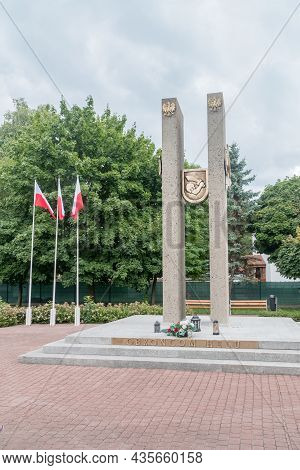 Hel, Poland - July 20, 2021: Polish Flags And Monument To The Defenders Of Hel.