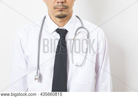 Headshot Of Handsome Asian Man Doctor Diagnose With Stethoscope On White Background.