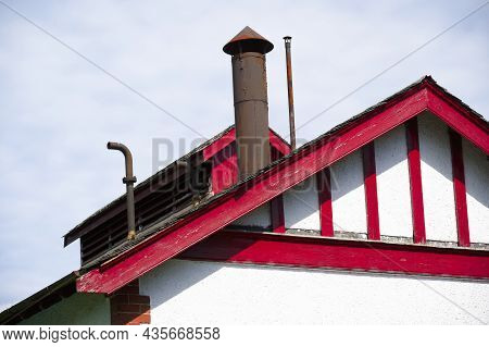 Flue Chimney Fixed To Building Exterior Slate Roof
