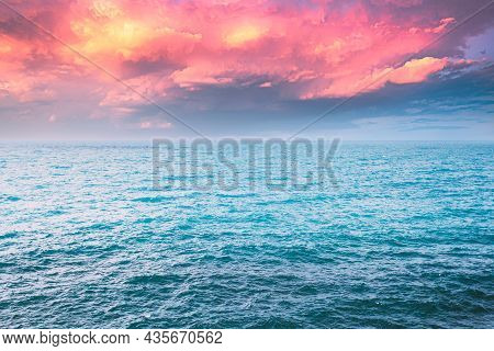 Sea Ocean And Blue Sky Background With Cloudscape In Summer.