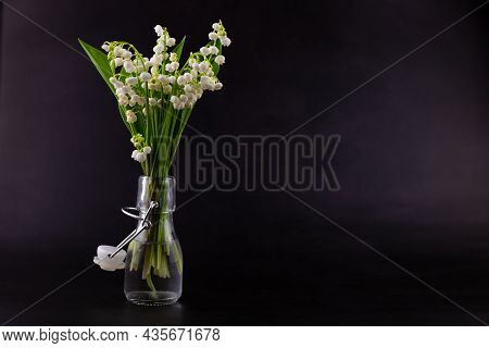A Bouquet Of Lilies Of The Valley On A Black Background With Place For Text. Delicate White Spring F