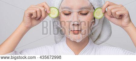 Asian Woman With Cucumber Slice For Anti Wrinkles And Treatment Eye Dark Circles. Treatment Eye Dark