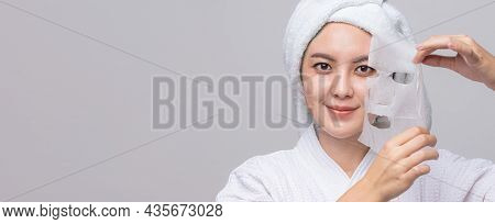 Asian Woman Pulling Away Mask From Her Face On Banner With Copy Space. Treatment Hyperpigmentation A