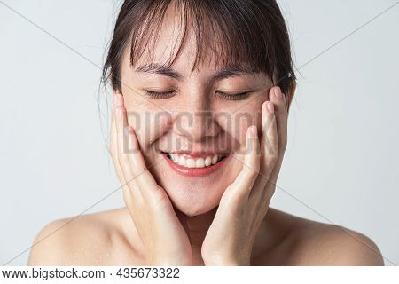 Freshness Smiling Of Young Asian Female With Water Drop On Her Face. Close Up Face Asian Woman Washi