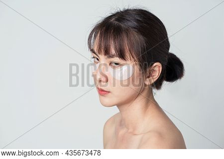 Asian Woman In Fatigue Emotion And Use Patches Collagen Under Eyes For Anti Wrinkles And Eye Dark Ci