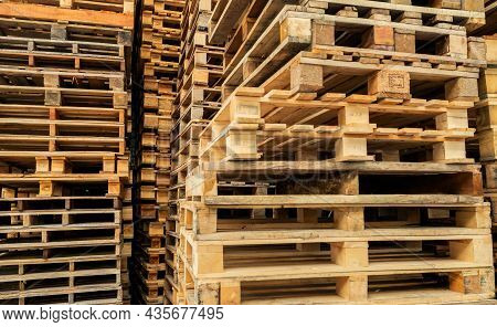 Stack Of Wooden Pallet. Industrial Wood Pallet At Factory Warehouse. Cargo And Shipping Concept. Sus
