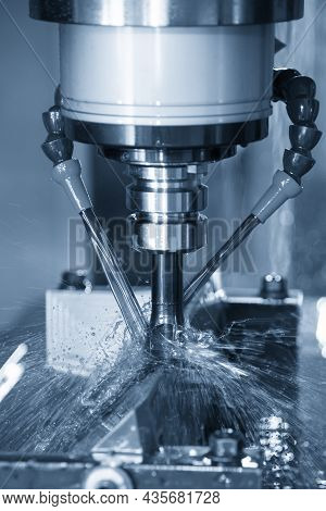 The Vertical Scene Cnc Milling Machine Cutting The  Mold Parts With Oil Coolant Method. The Mold And