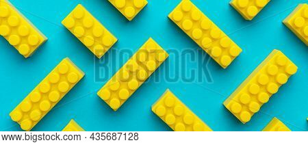 Top View Of Plastic Blocks Background. Flat Lay Image Of Toy Background Made With Yellow Building Bl