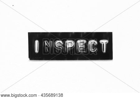 Black Color Banner That Have Embossed Letter With Word Inspect On White Paper Background