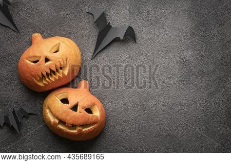 Halloween Pumpkin Flatlay, Copy Space Photo On Dark Background Template. Two Scary Autumn Pumpkins W