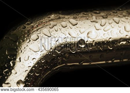 Abstract Background. Yellow Metal Pipe Covered Water Droplets. Raindrops On Bend Of Metal Pipe Isola