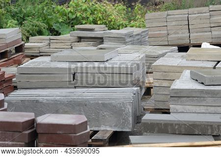 Samples Paving Slabs Of Various Shapes And Colors At Construction Site. Diversify Assortment Samples