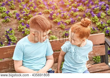 Little Girl And Boy At Backyard. Green Casual Dress. Family Outdoor Portrait. Female And Male Childr