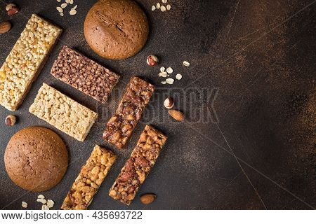 Different Energy Protein Bars On Dark Background. Healthy Granola Superfood Bars. Copy Space