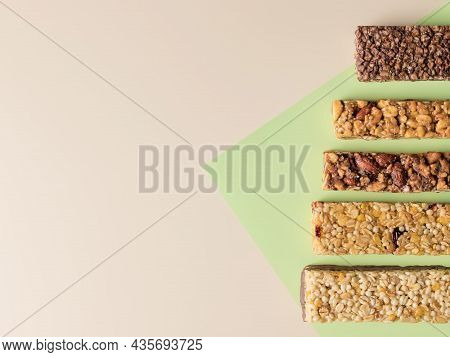 Different Energy Protein Bars On Color Background. Healthy Granola Superfood Bars. Flat Lay, Copy Sp