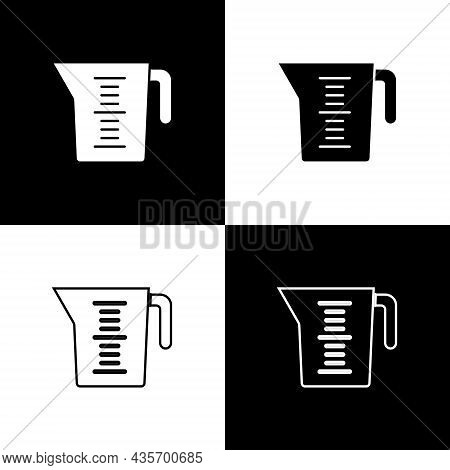 Set Measuring Cup To Measure Dry And Liquid Food Icon Isolated On Black And White Background. Plasti