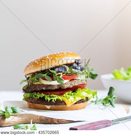 Double Cheeseburger With Veal Cutlets, Tomatoes, Lettuce Leaves And Cucumbers. Fast Food.