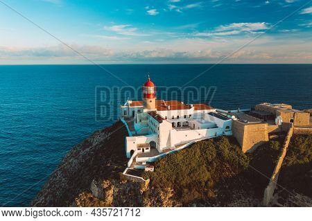 Aerial View Of Lighthouse Of Cabo De Sao Vicente Or Cape Of Saint Vincent Located On High Cliffs Nea